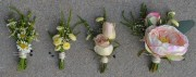 Left to Right-- Groom Boutonniere, Groomsmen Boutonniere, Father Boutonniere, Mother Corsage